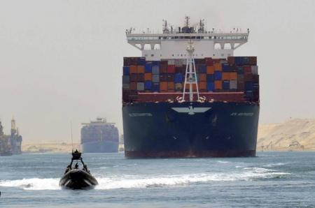 FILE PHOTO: A cargo ship is seen crossing through the New Suez Canal