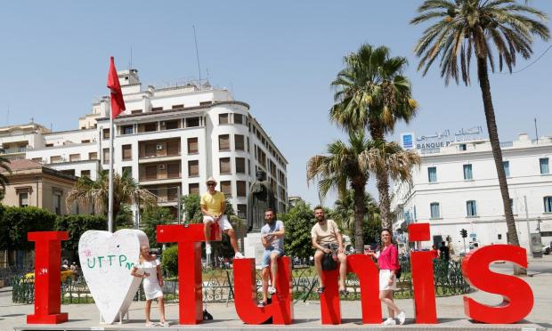 Tourists poses for picture in downtown Tunis